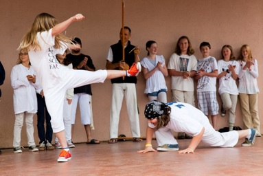 kids playing capoeira at school